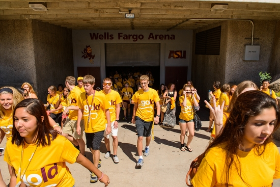 students walking out of Wells Fargo Arena