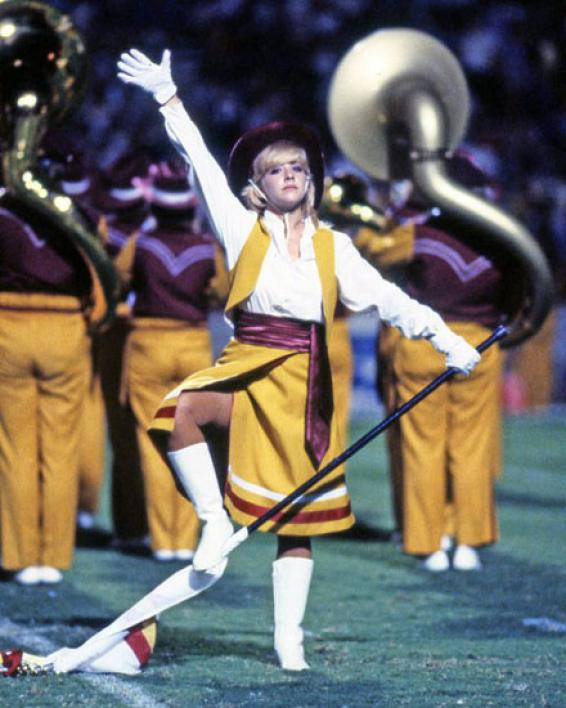 colorguard member performing with marching band