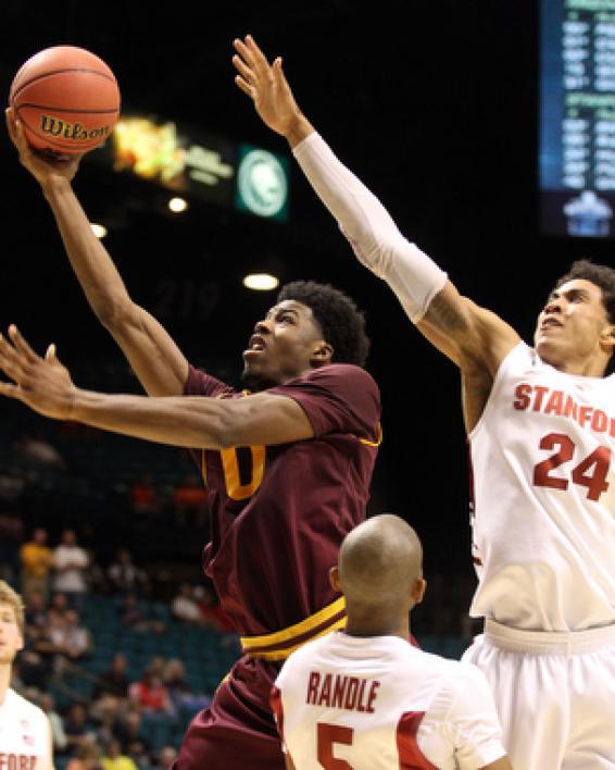 basketball player going for layup