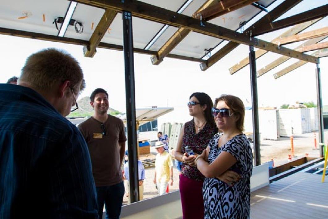 people touring dining room in SHADE home
