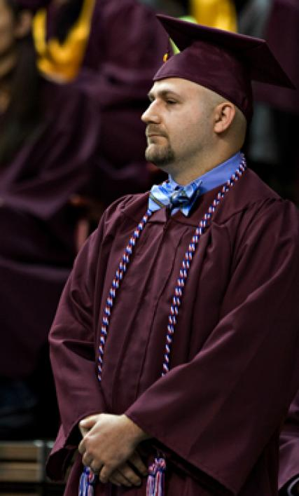 man in cap and gown
