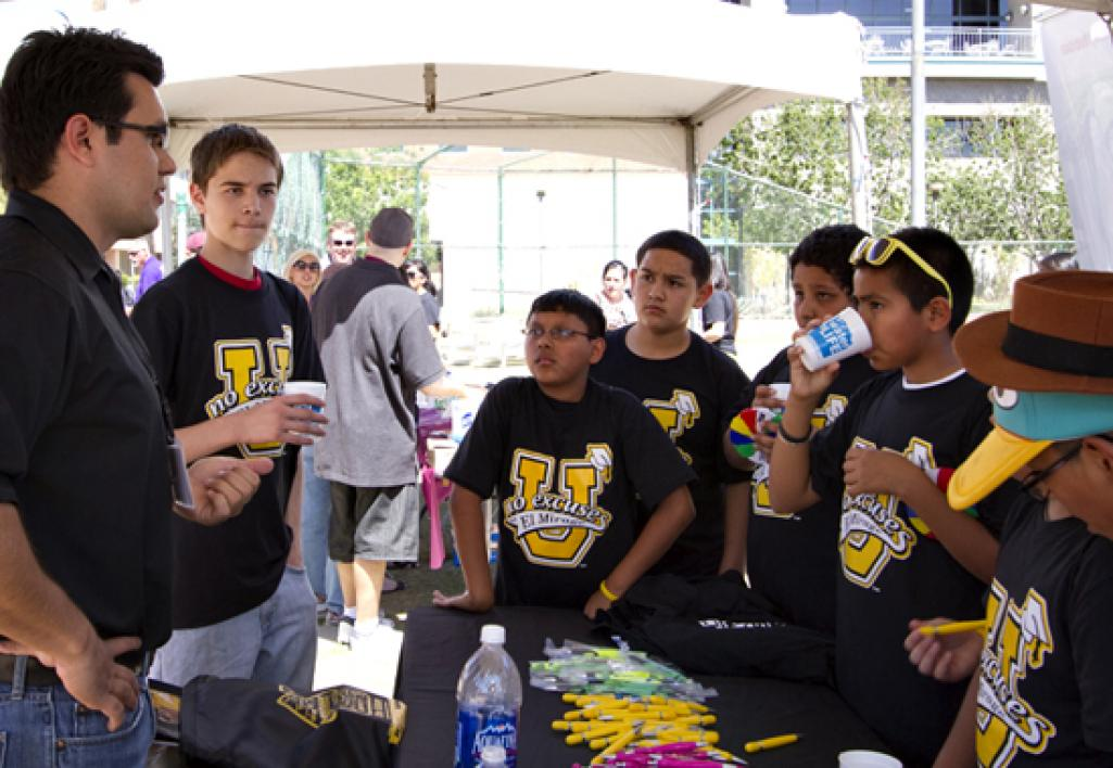 man talking with students