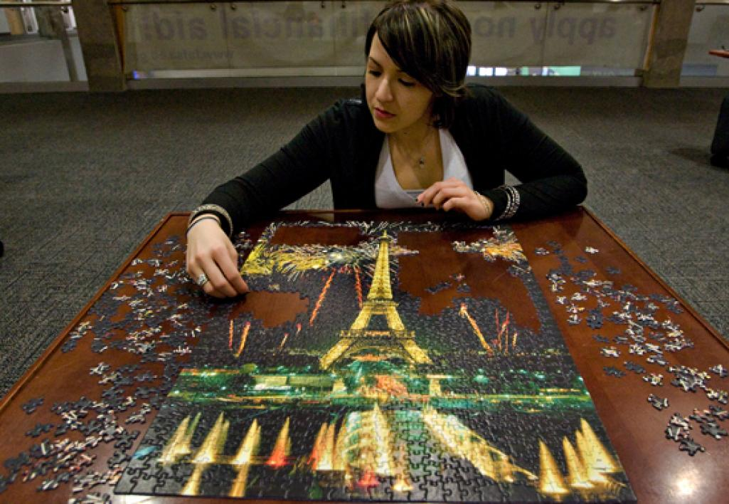student working on puzzle