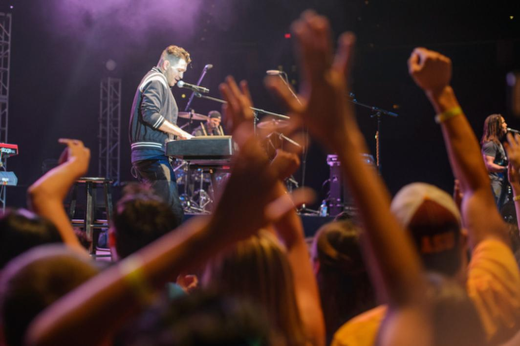Andy Grammer performing on stage