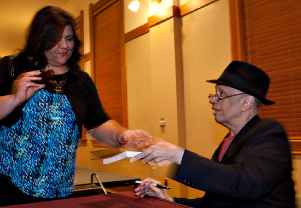 man signing book