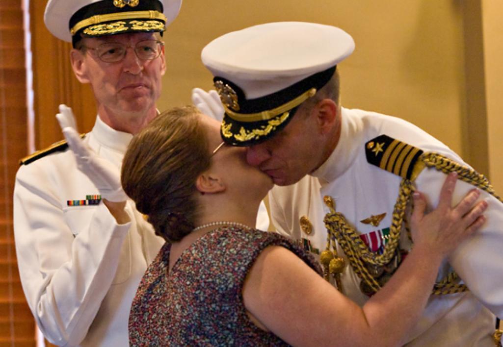 woman giving husband a kiss