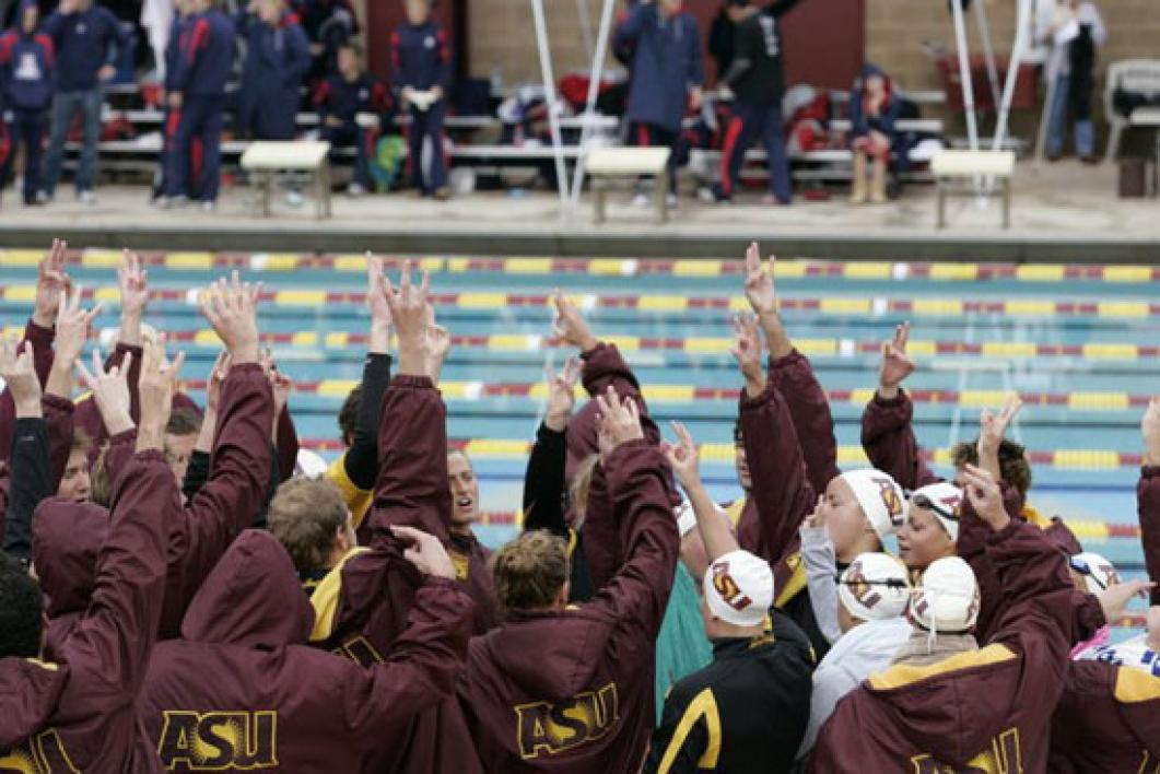 swimming and diving team celebrating