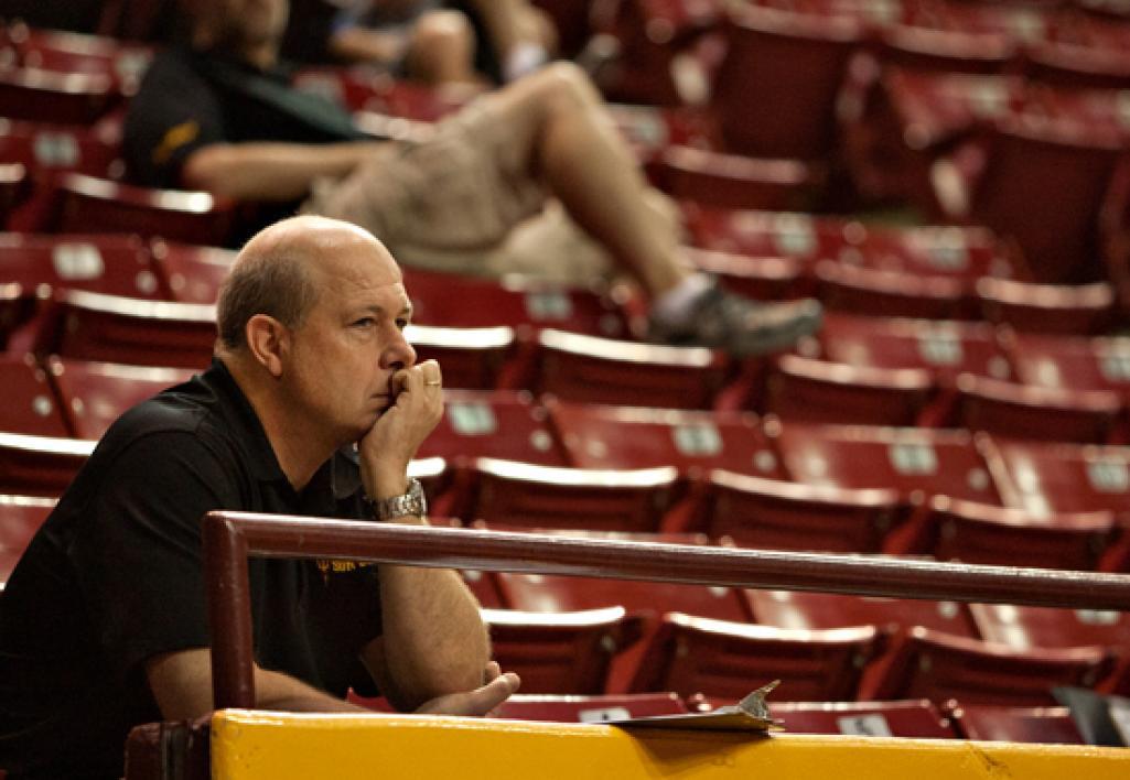 coach watching basketball game
