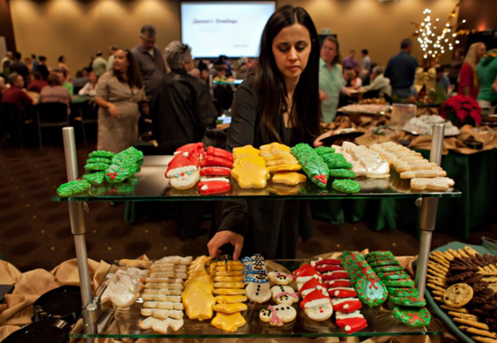woman choosing cookie from table