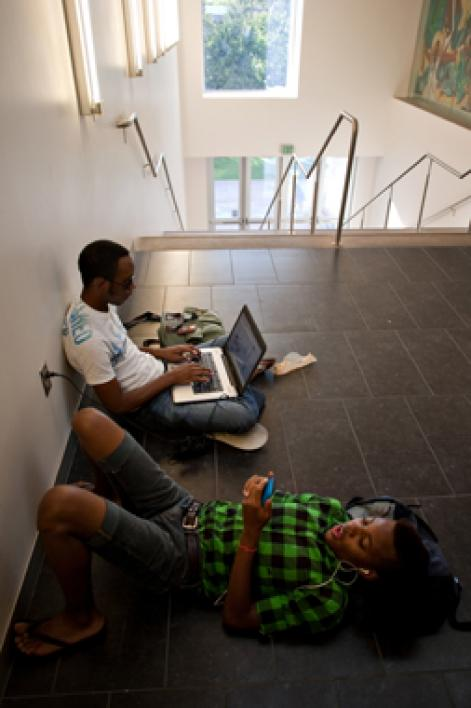 two students sitting on floor in Memorial Union