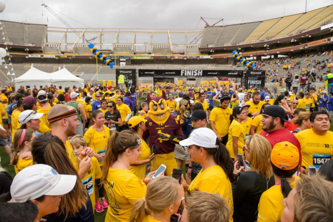 Sparky poses with fans at finish line