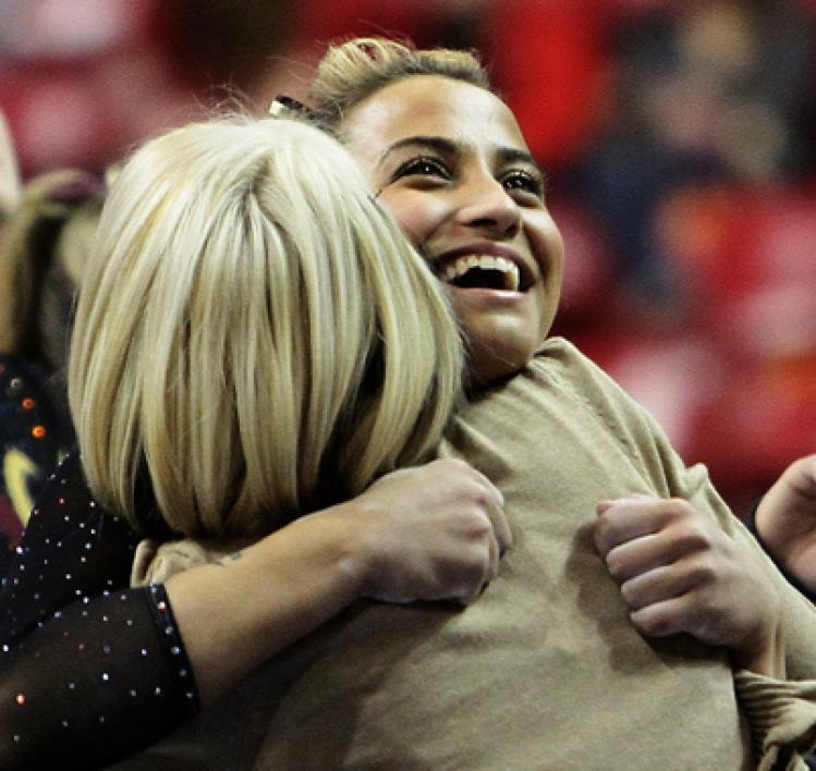 gymnast hugging coach
