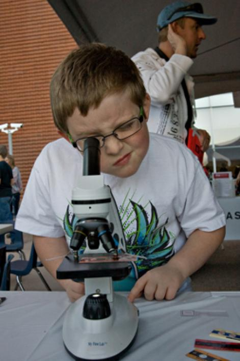 boy looking in microscop