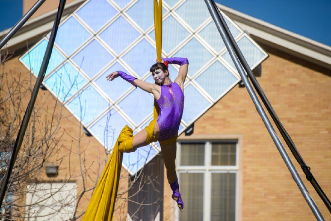 circus performer suspended in ribbon