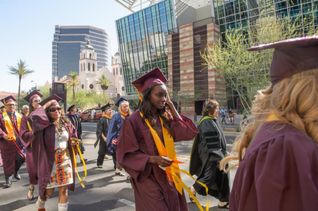 graduating nursing students marching in line in downtown Phoenix for convocation