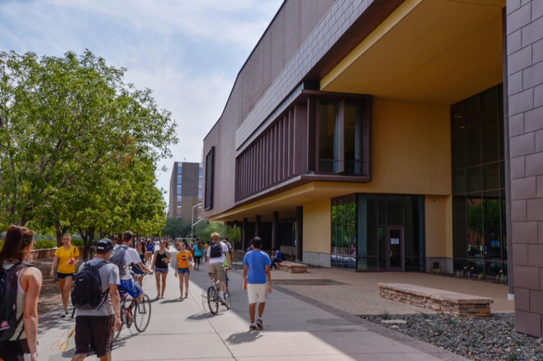 people walking next to Sun Devil Fitness Complex on the Tempe campus