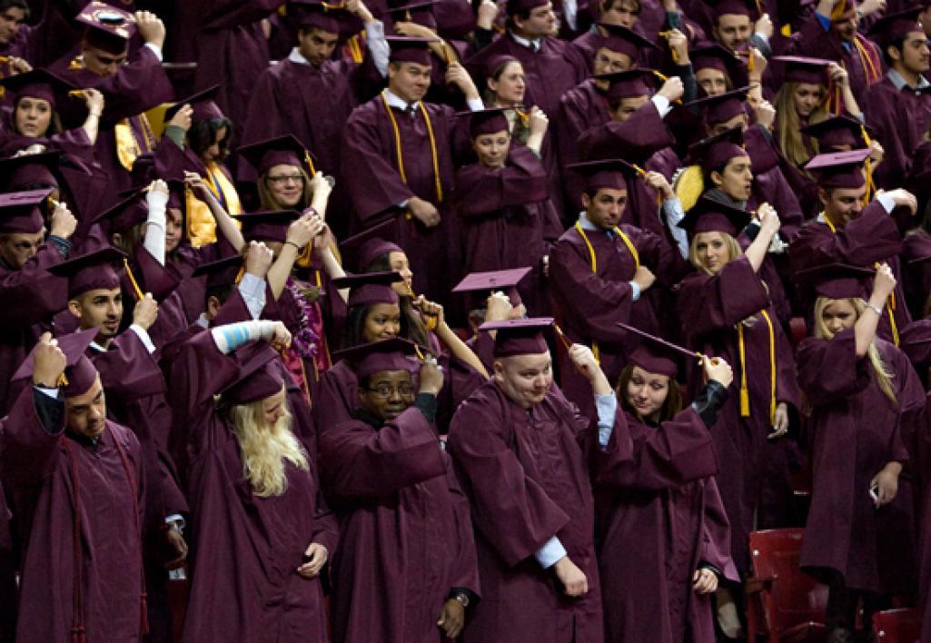 graduates flipping tassles