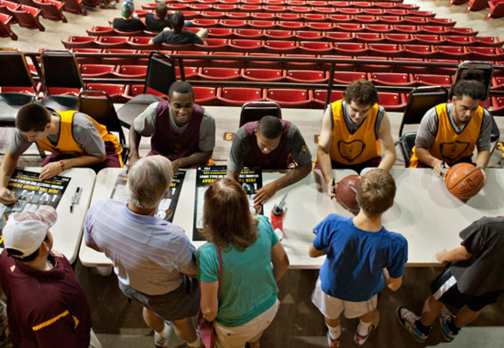 basketball players signing autographs