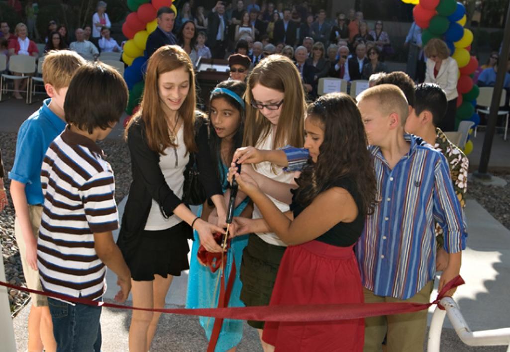 kids cutting ribbon