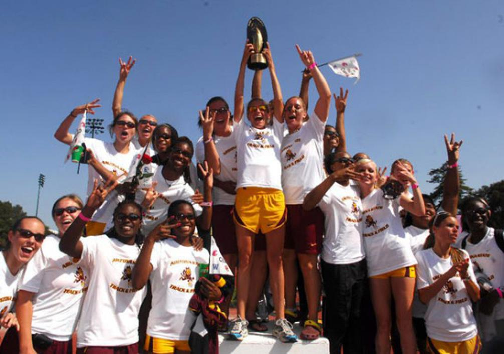 track and field women's team with trophy