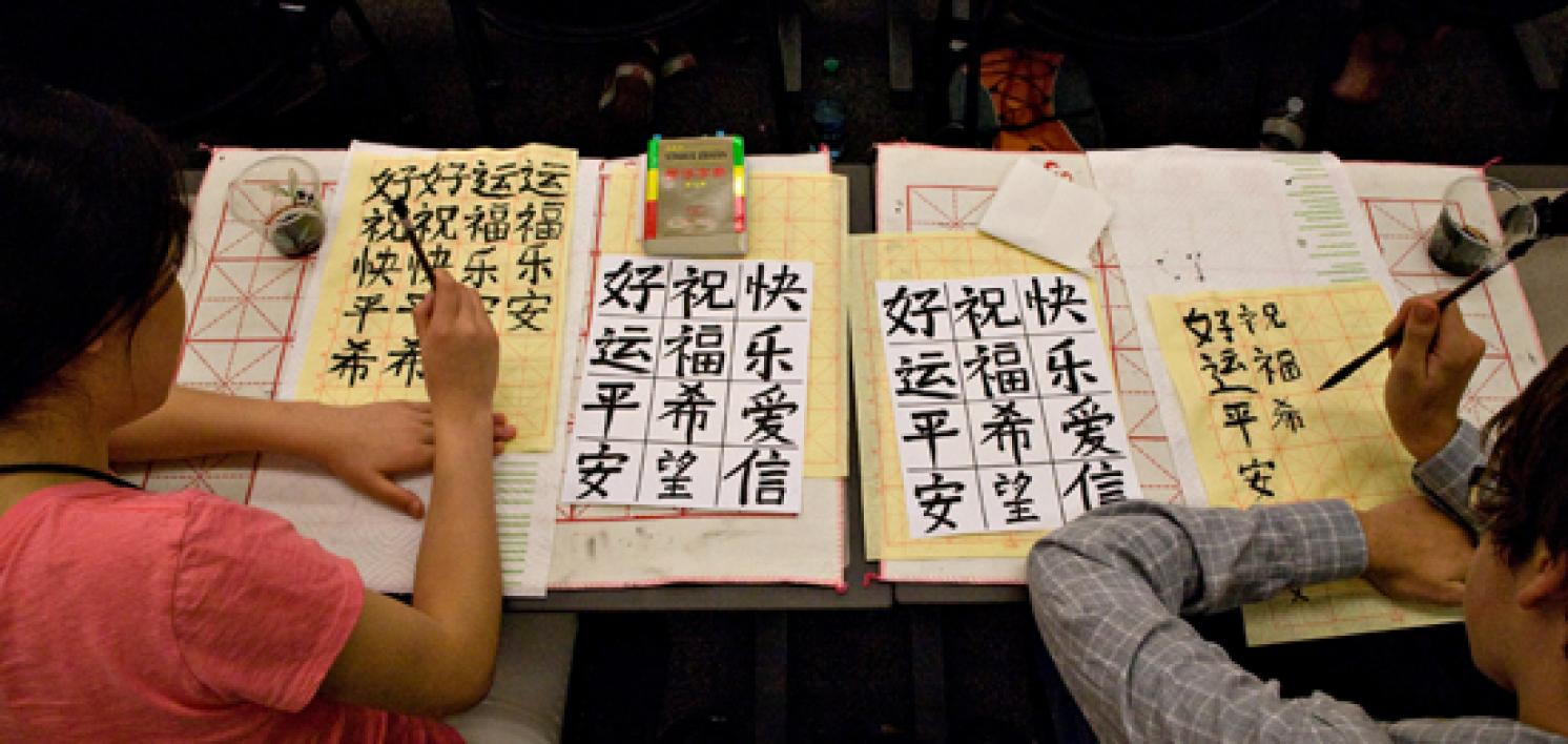 campers practicing Chinese calligraphy