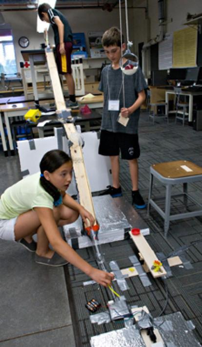 campers working on Rube Goldberg machine