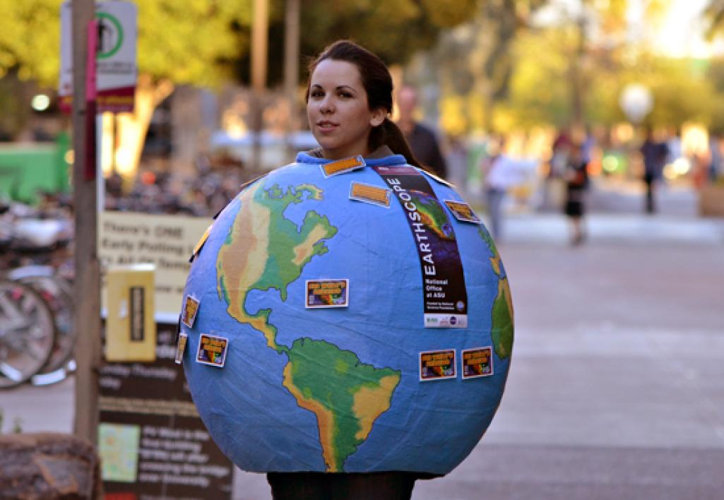 student dressed as a globe