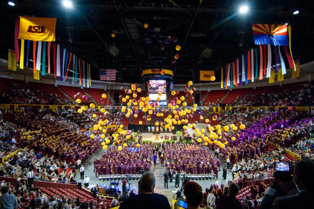 balloons dropping over crowd of graduates in Wells Fargo Arena
