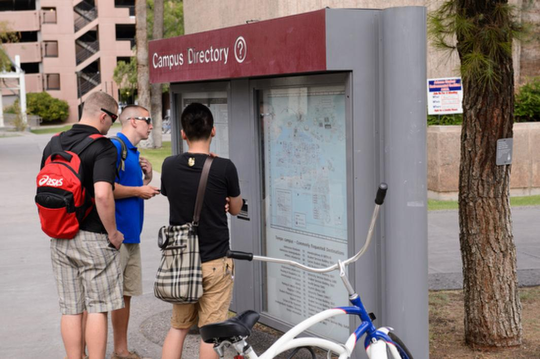 students looking at campus directory