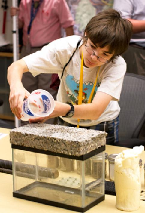 student working with pavement sample