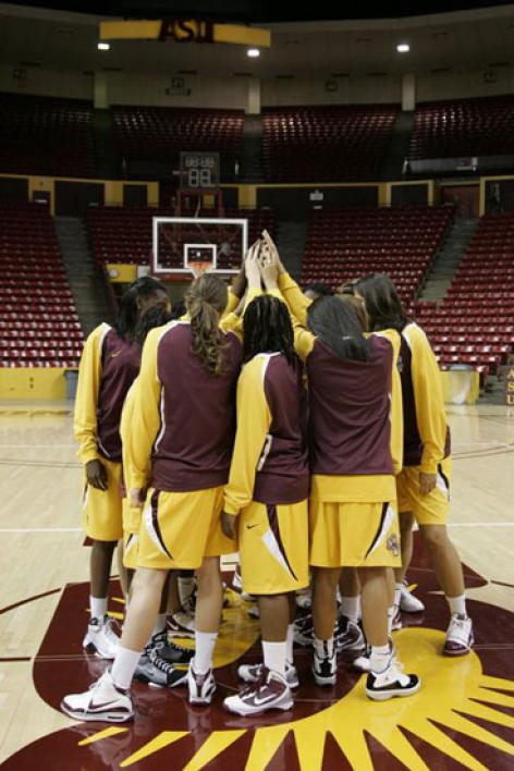 women's basketball team in for a huddle