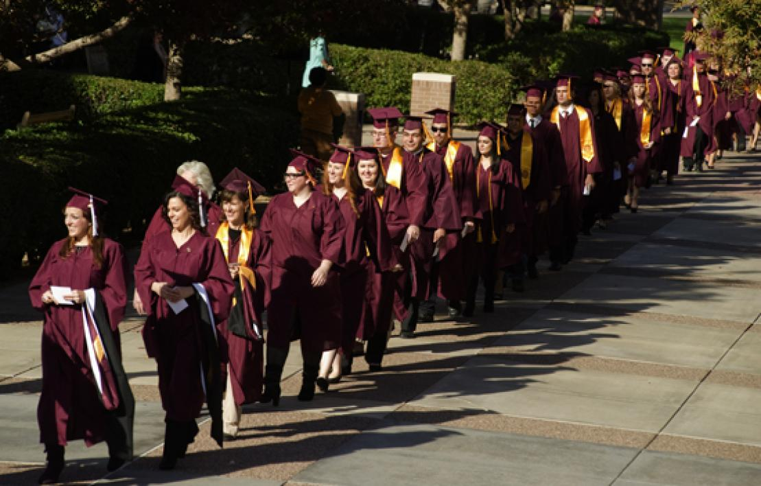 parade of graduating students on West campus