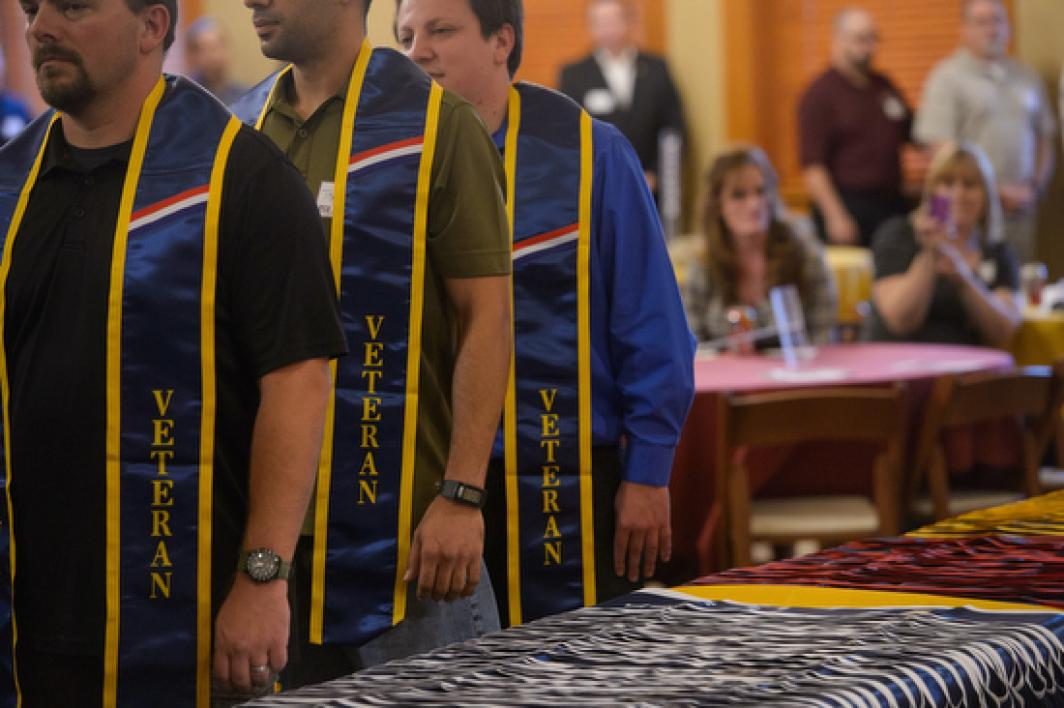 graduates wearing veteran sashes