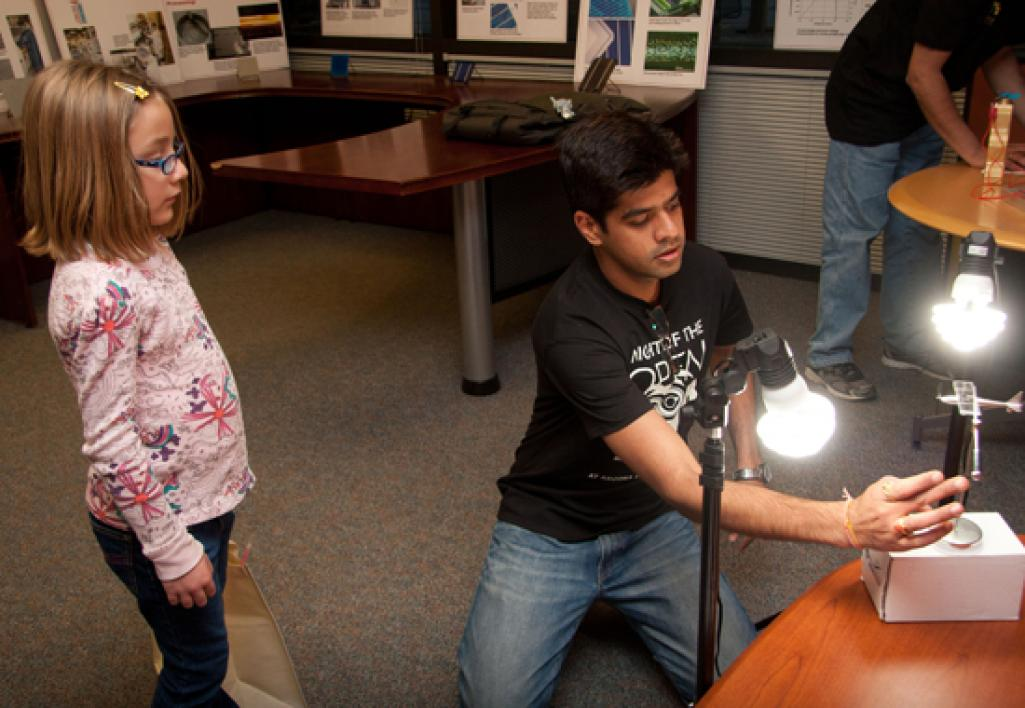 girl watching electrical demonstration