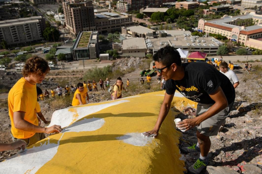 """students painting the """"A"""" on Tempe Butte"""