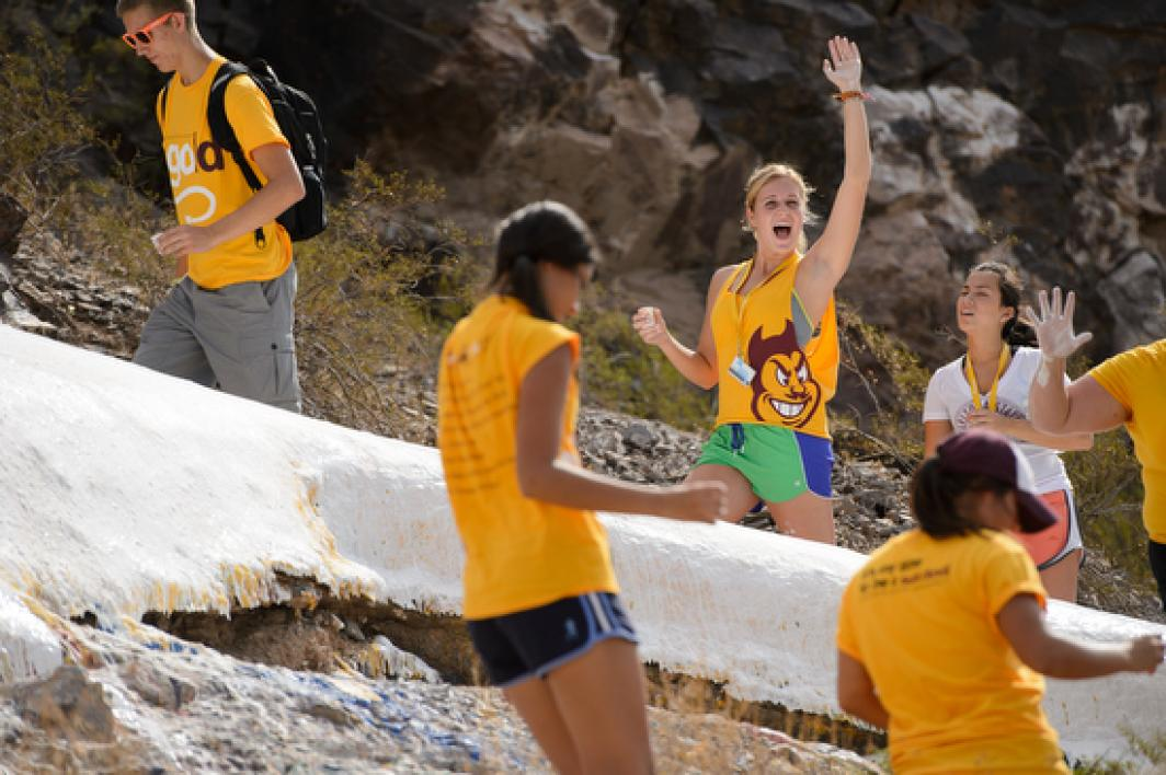 "students whitewashing the ""A"" on Tempe Butte"