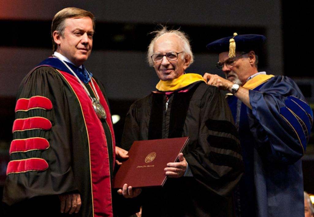 man holding honorary degree