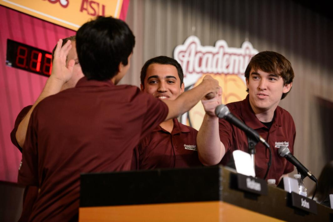 Engineering Maroon teammates fistbumping
