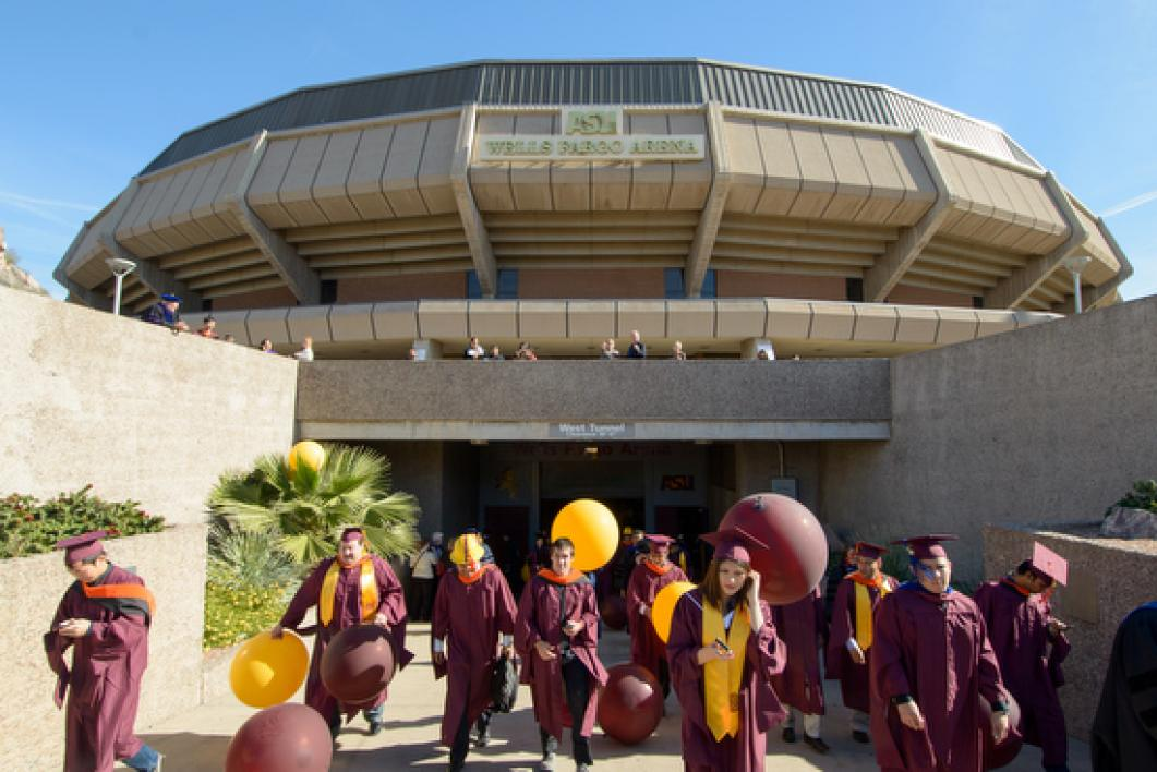 graduated students walking out of Wells Fargo Arena