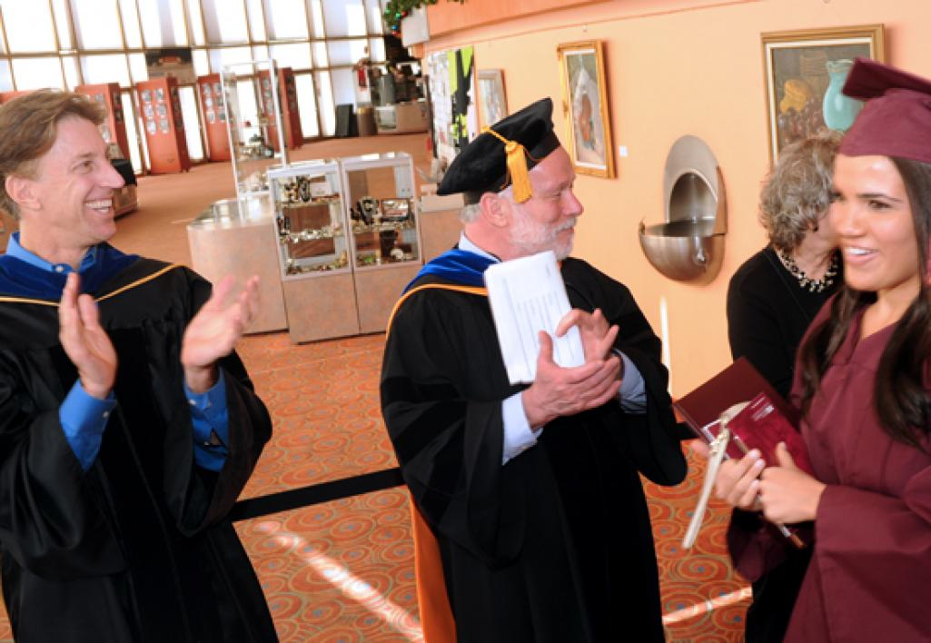 faculty saluting graduates