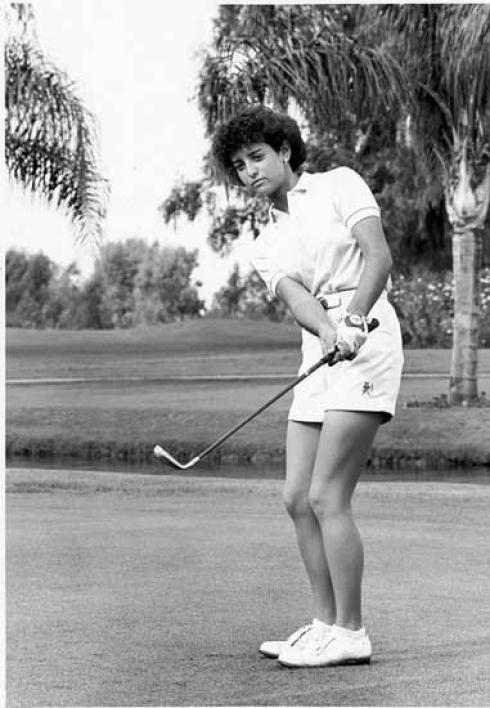 Danielle Ammaccapane golfing