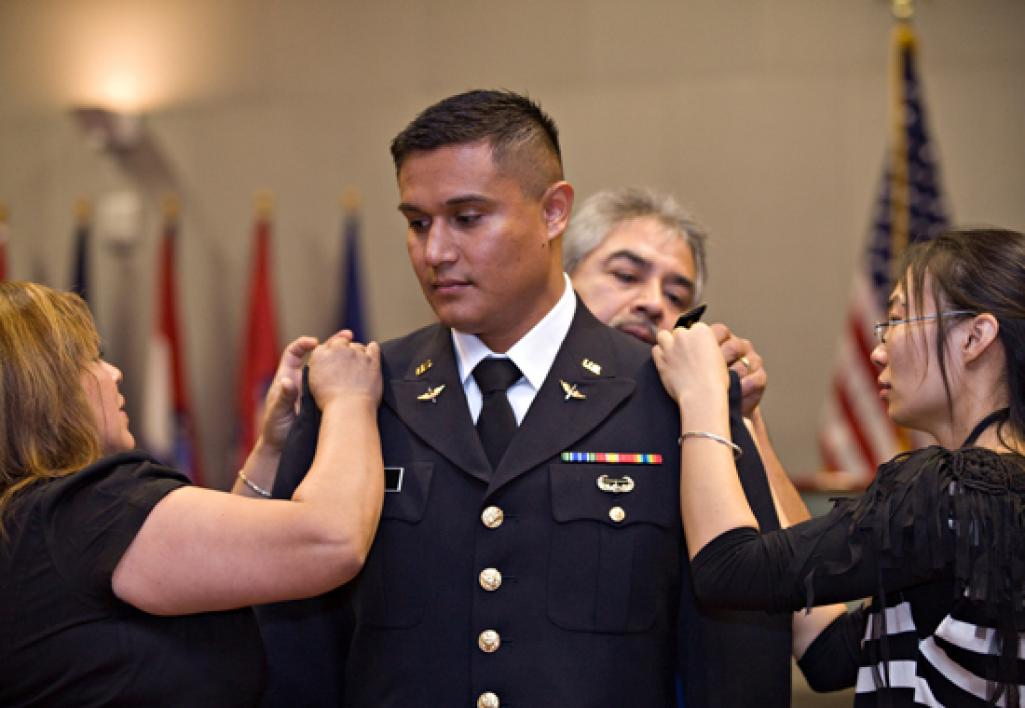 man getting pins put on his uniform