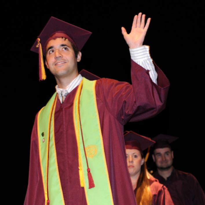 student waving