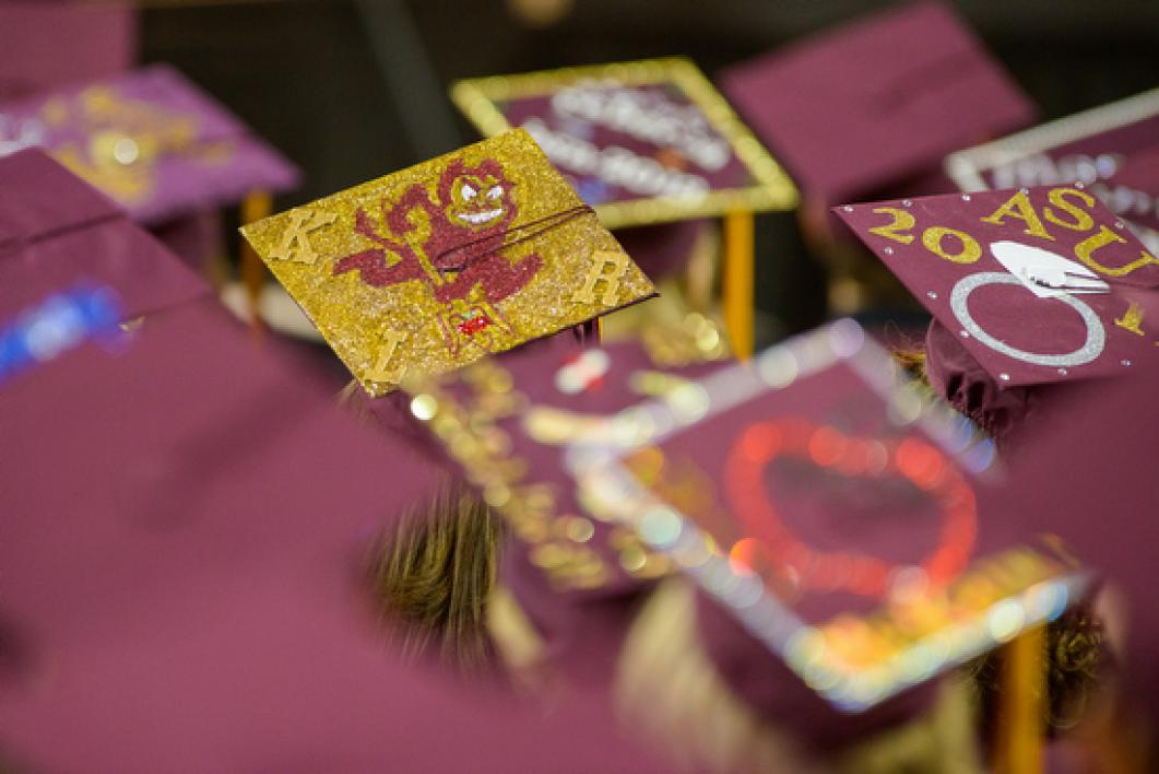students in decorated mortarboards