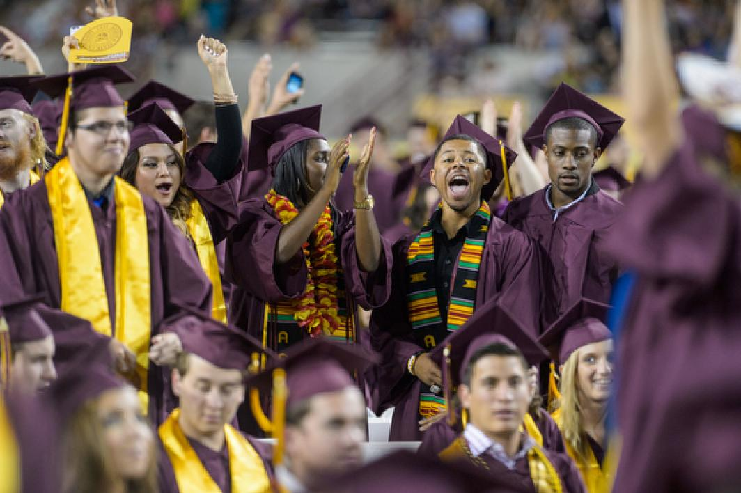 Proud ASU grads stand in recognition
