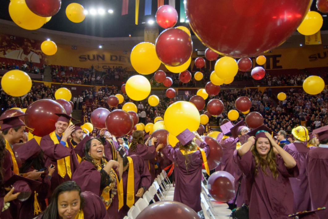 students celebrating graduation balloon drop