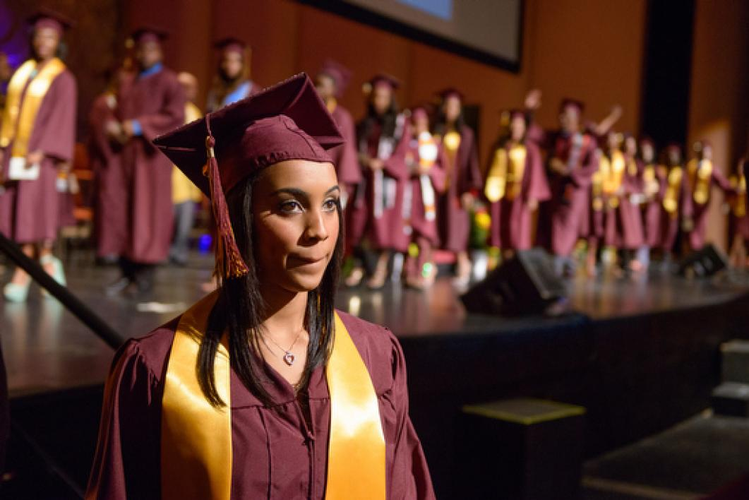 graduate walking out in front of stage during ASU Black and African Convocation
