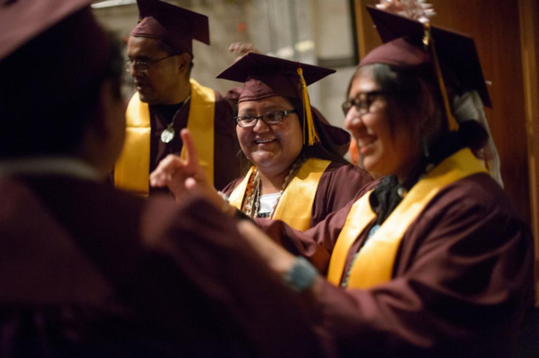 graduates talking before ASU American Indian Convocation