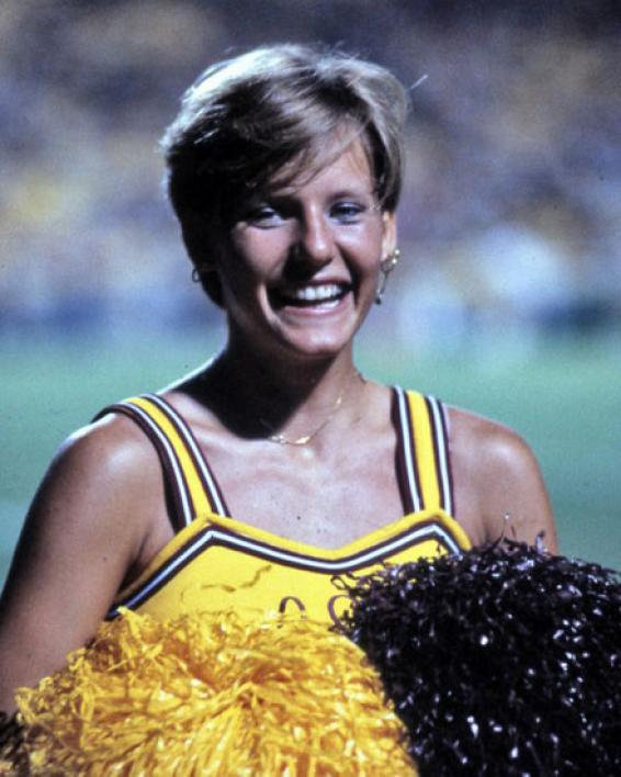 cheerleader with pompoms