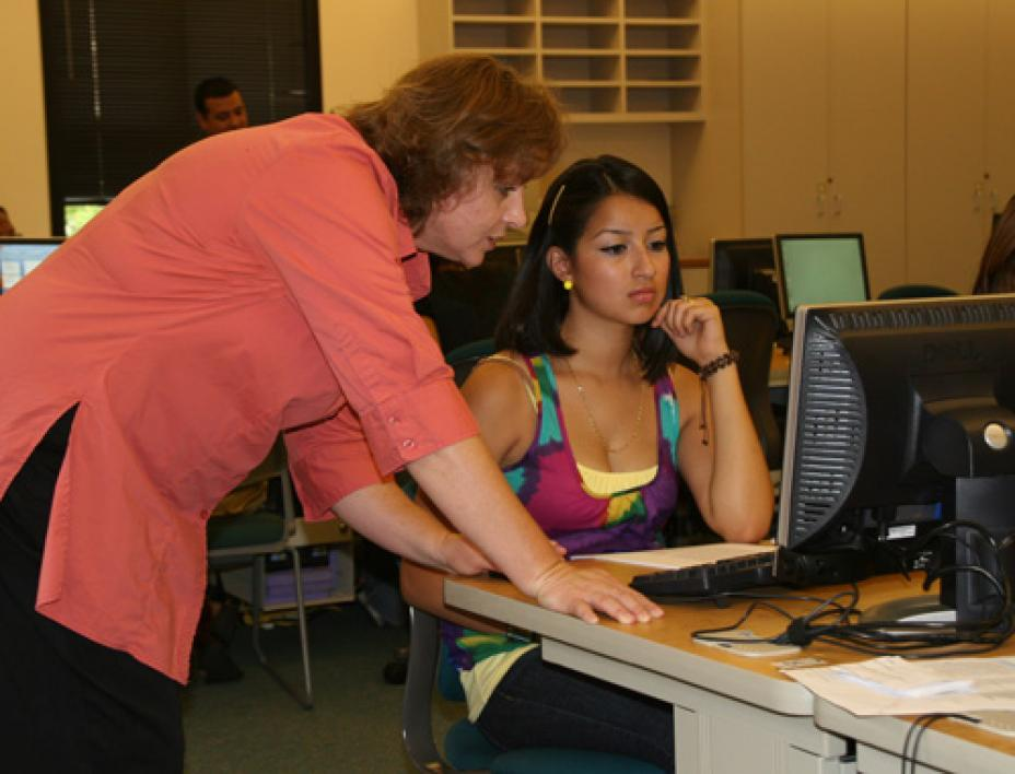 grad student and student on computer